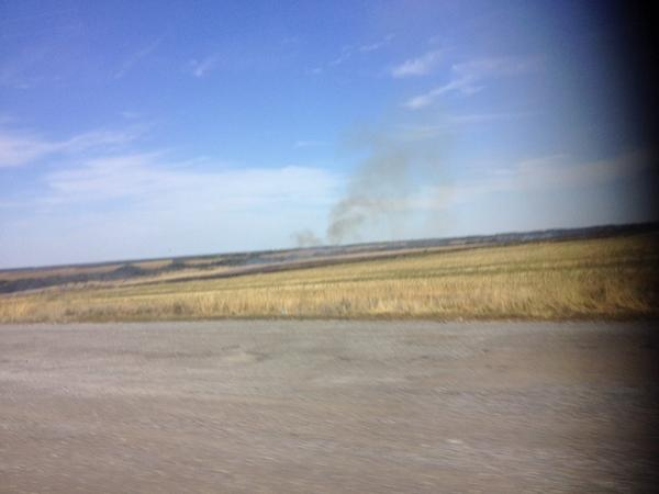 Smoke comes from farmers burning fields of wheat stubble