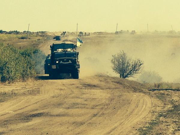 Ukrainian military vehicles abandoning camp near Starobilsk, in face of what they say are rockets fired fm Russia.