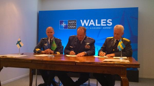 Finland and Sweden signing the HNS MoU with NATO at @NATOWales  NATOsummitUK