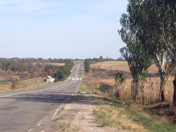 Distance cement structures to stop tanks outside of Mariupol