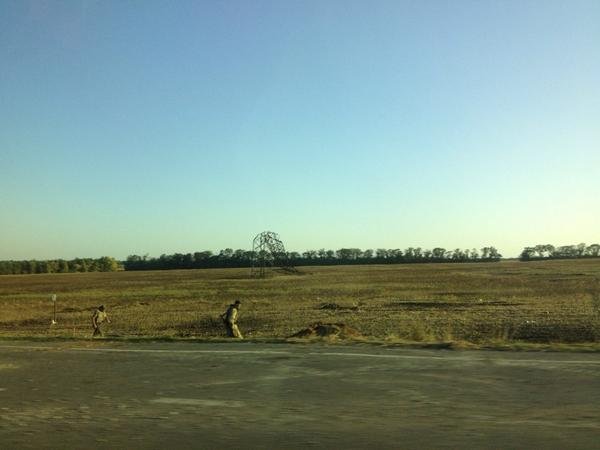 Downed power lines in Marinka outside Donetsk. Down the road a grain elevator full of shell holes. Smoke on horizon