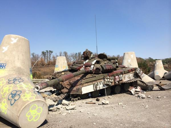 Tank - hit by fire between tank traps outside Mariupol on the road to Novoazovsk