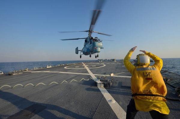 The Ukrainian Navy Ka-27 langing on the deck of the destroyer USS Ross during exercise Sea Breeze-2014 in the Black sea