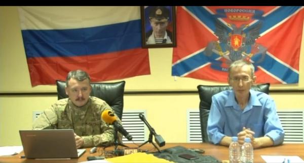 Girkin, user El Murid and Putin in the background