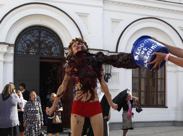 Ukraine: Femen protests vs Russia Orthodox church in Kiev w bloody bucket