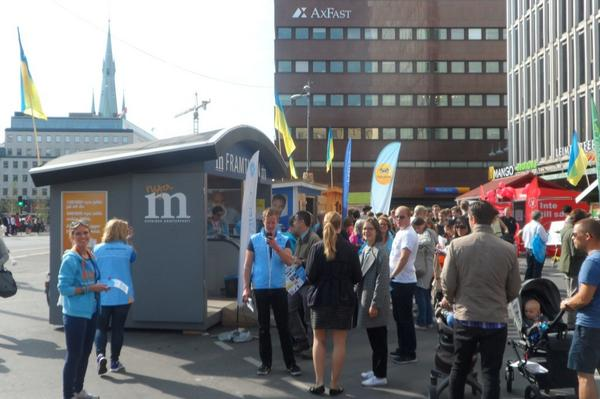 Note flags of Ukraine in solidarity on campaign booths of all major Swedish political parties. Except the extremes