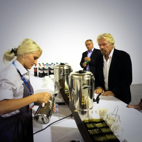 Billionaire Richard Branson drinks coffee from a paper cup. YESUkraine2014