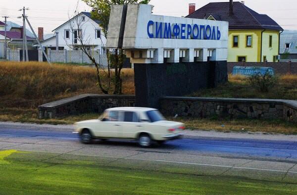 Pro Ukraine Art Partisans movement in Crimea paints main high way in yellow/blue. Crimea Ukraine