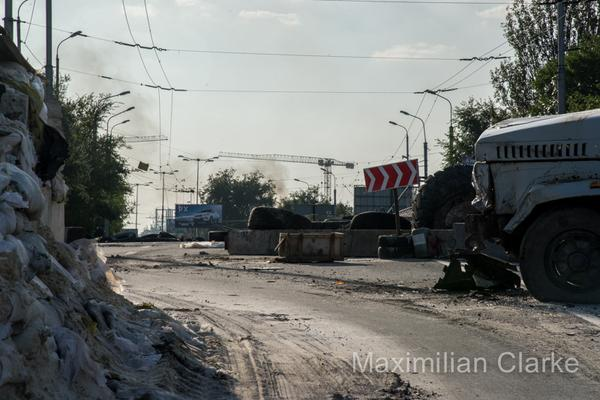 DNR howitzers pummelling DonetskAirport this afternoon. Photo of smoke from final checkpoint