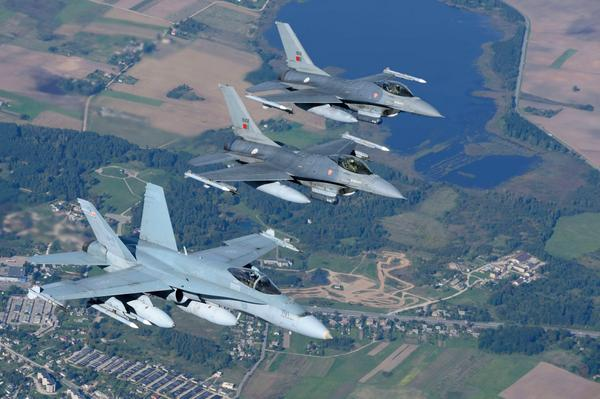 Canadian and Portuguese fighter jets fly side by side to protect Baltic airspace @RCAF_ARC CF18