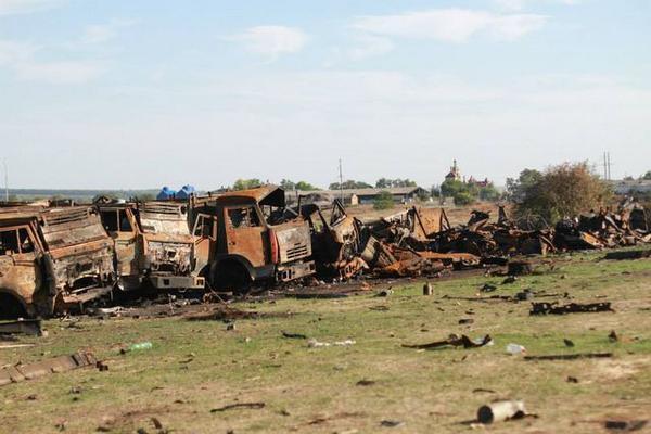 Ukrainian vehicles near Dmitryvka after Russian MRLS attacks