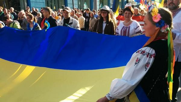 Lots of Ukrainian flags and national dress at protests in Russia today.