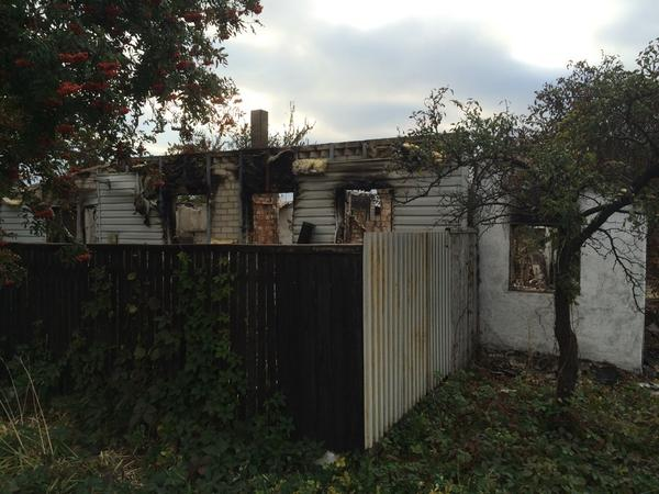 Home in Debaltseve destroyed by rockets. Area bridge blown by DNR before retreat from positions