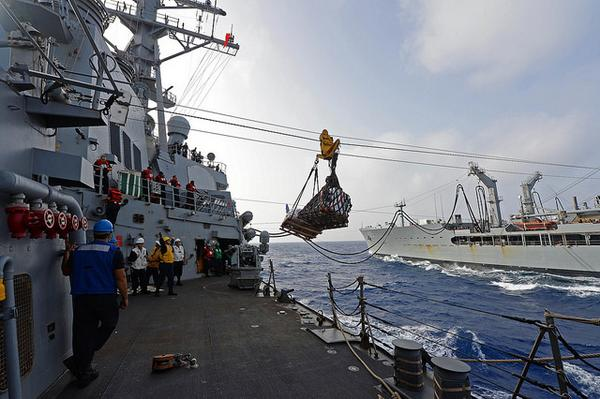 Mediterranean Sea-- Guided-missile destroyer USS Cole in replenishment-at-sea with USNS Leroy Grumman