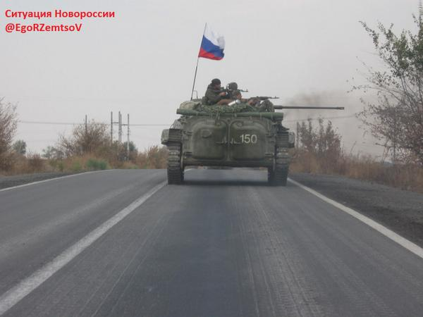 Russian militants with Russian flag in Ukraine