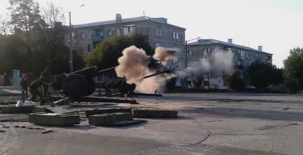 Russian militants shelling with D-30 howitzers from residential area