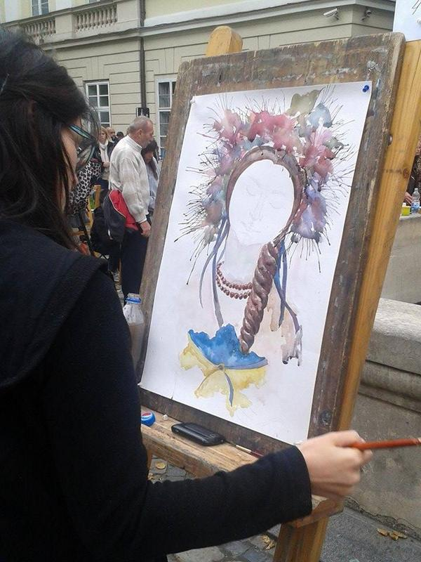 Lviv: adults & children on Rynok sq painted United Ukraine. Works displayed, best awarded.