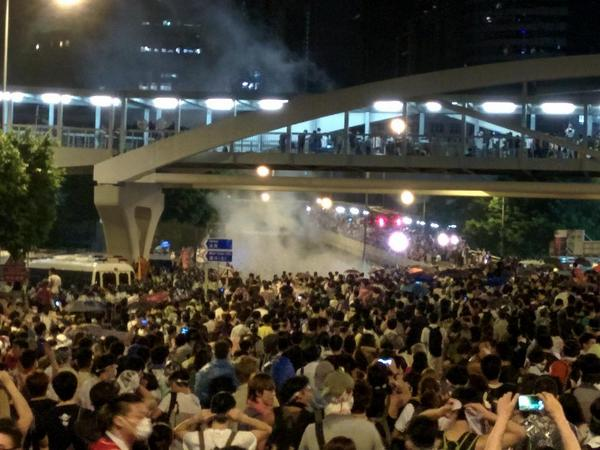 More tear gas in Admiralty. People yelling f*ck your mother to police standing on overpass. occupycentral