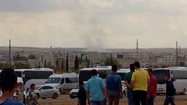 In Kobane smoke after explosions to see ISIS Turkey Syria