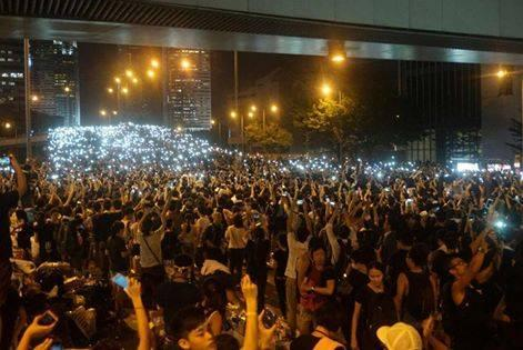 The crowd lights up with their mobile devices and shout, Step down, CY Leung hongkong
