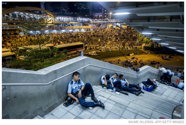 Policemen resting today with protesters behind: OccupyCentral