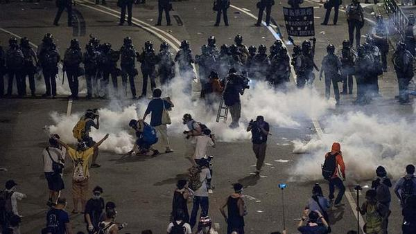 Protesters in Hong Kong hold their ground even after police attack them with tear gas.