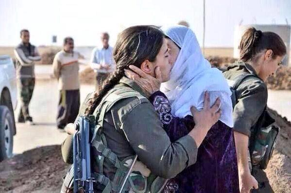 Kurdish mother gives a sweet kiss to her daughter before she goes to fight ISIS on the frontline