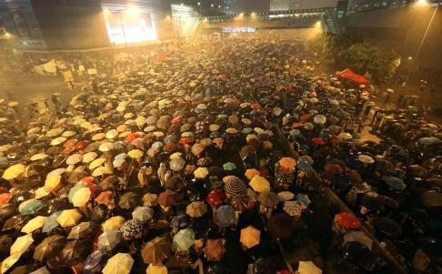 Rainstorm in Hong Kong allows protesters use umbrellas as (Chinese) manufacturers intended.
