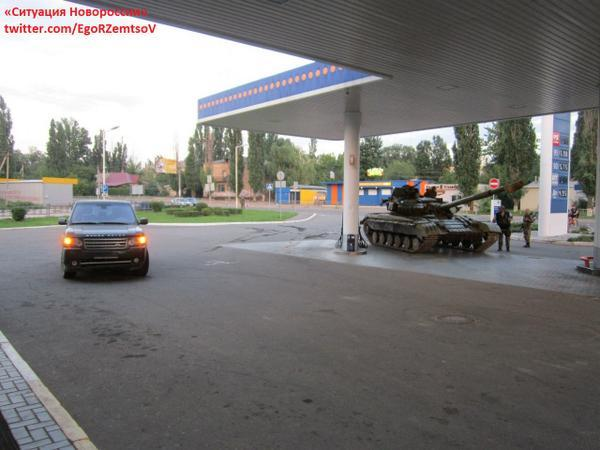 Russia terrorists tanks on Russian TNK gas station in occupied part of Ukraine