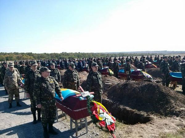 In Zaporozhia, 54 unidentified soldiers killed in Ilovaisk are buried.