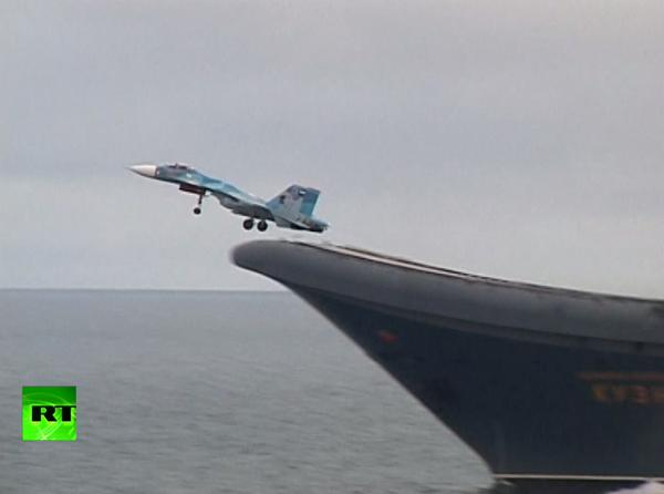 Arctic drills: Russia's Northern fleet pilots polish deck takeoff & landing skills