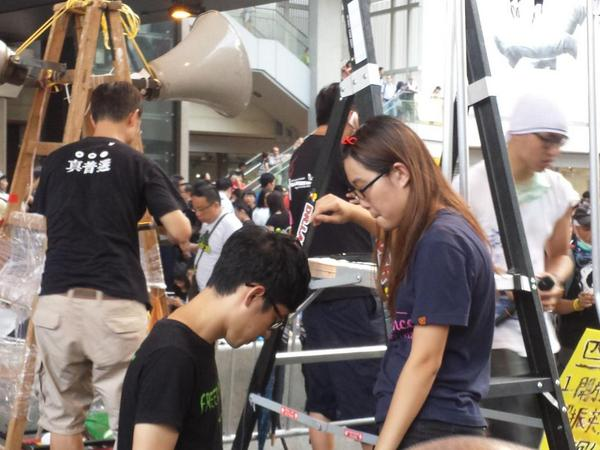 Student leader Agnes Chow says police are amassing, asks protesters to tell friends to come