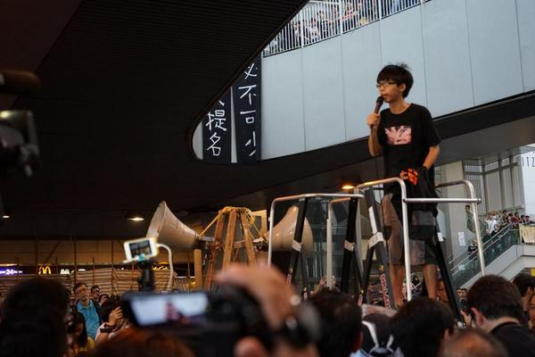 Joshua Wong warns crowd tear gas bombs may be used again tonight