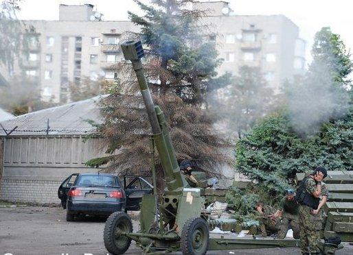 Donetsk militants happily firing artillery from residential areas