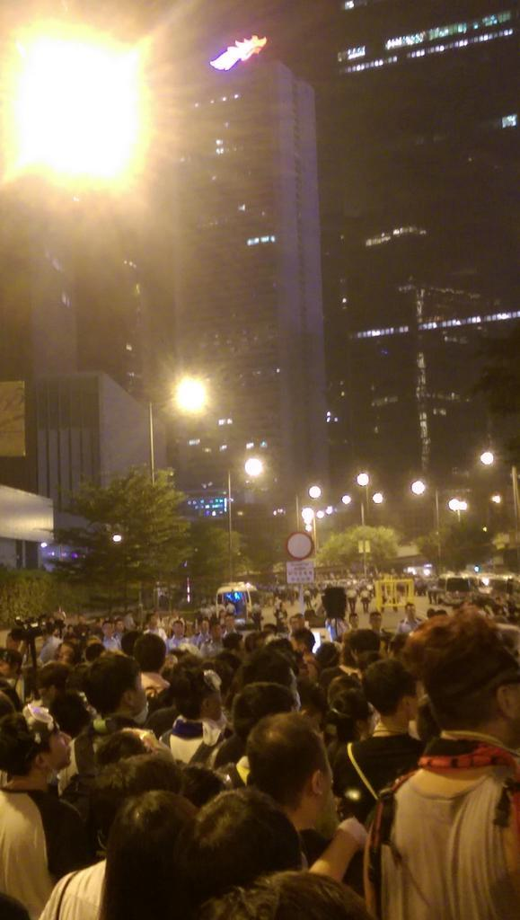 Police said they put on riot gear for peacekeeping. Crowd shouts liars  OccupyCentral UmbrellaRevolution