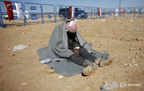 A 100-year old Syrian Kurdish refugee waits for transportation in Turkey