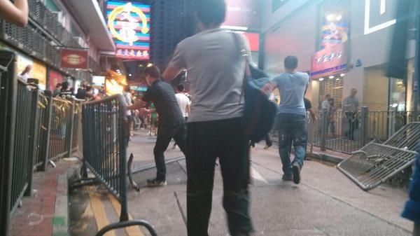 Abt 20 men in masks tear apart and toss barricades OccupyCentral OccupyHK UmbrellaRevolution UmbrellaMovement