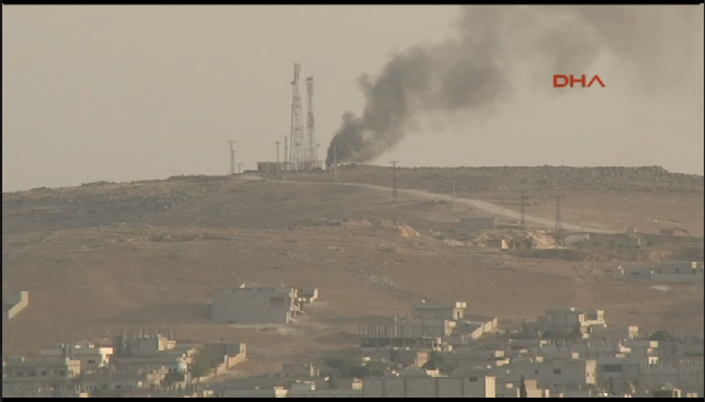 Radio tower outside of Kobane  is on fire