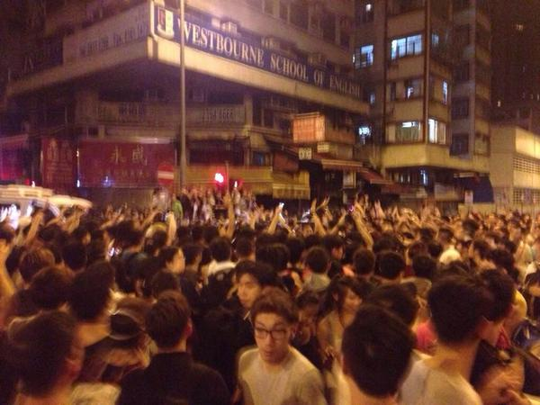 Protesters rush in as police reportedly threaten to hit others with batons