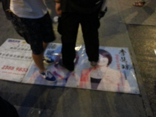 HK democracy protesters in Mong Kok step on banner of pro-Beijing DAB party as sun rises over city