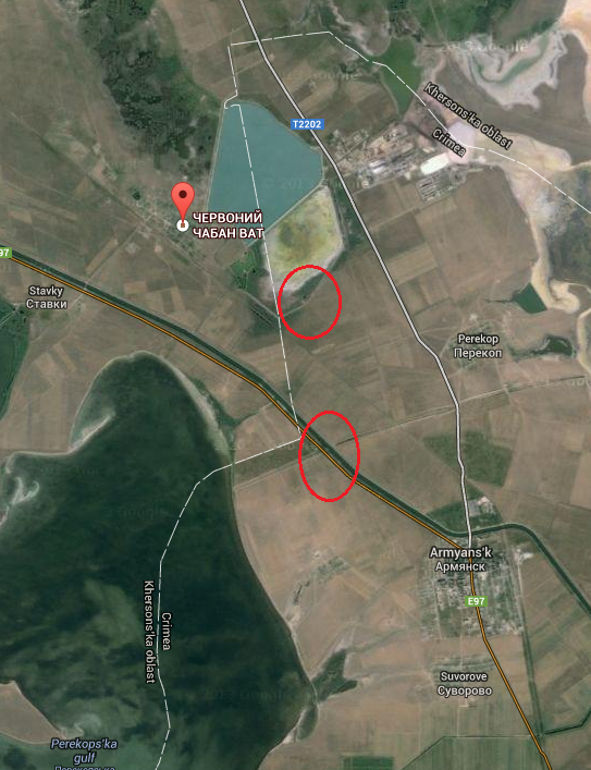 Russian armored vehicles and tanks move in northern occupied Crimea only meters from Ukr mainland