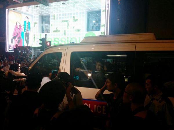 Police just arrested two men onto police car. Identify unknown. Mongkok hongkong