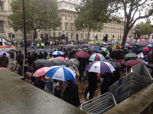 Kurdish protestors wistfully observe obviously well-meaning Stop the War Coalition marchers pass 10 Downing Street