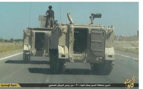 ISIS driving away with US-made APC's captured from Iraq army 30th brigade at Saqlawiya camp last week
