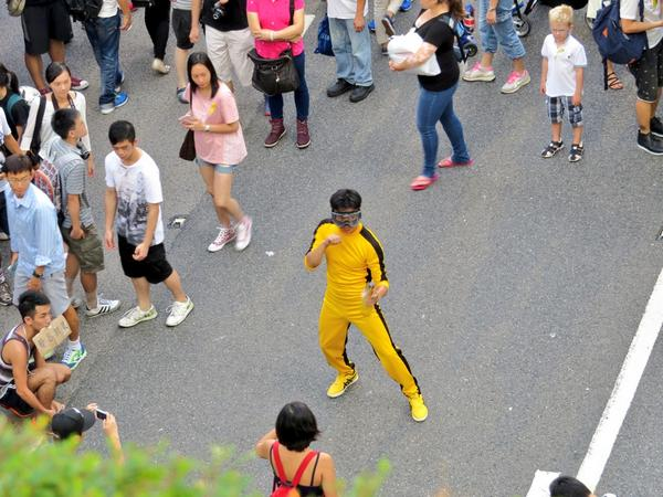 A Bruce Lee impersonator appears at the rally area in Admiralty HK, ready w/ his goggles and umbrella nunchucks.
