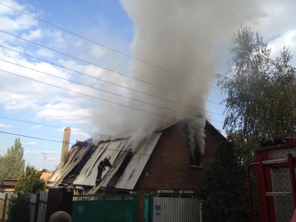 Firemen working in Donetsk on Sunday.