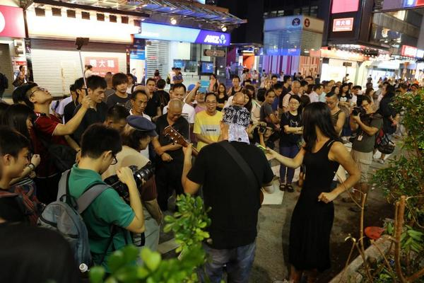 Less tense in Mongkok Sunday night, some guy breaks out a guitar