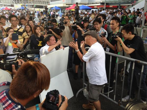 Lots of yelling at Admiralty. Counter-protester came with sign urging protesters to go home. Crowd not happy.