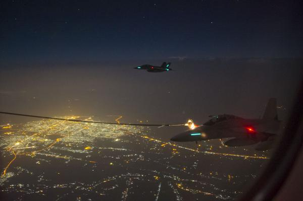 Australian F-18s refuel over Iraq during their first combat mission.