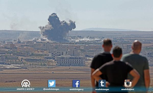 Smoke rises from Aynalarab city (Kobani) of Syria after the US-led coalition bombed the targets ISIL AA